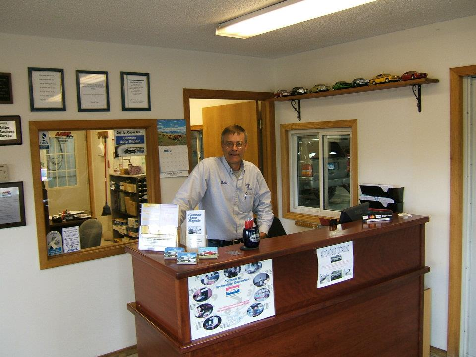 Rich udenberg shop owner at front desk of cannon auto repair in cannon falls mn